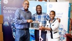 SHOFCO CEO kennedy Odede receiving the equipment from GE H .jpg